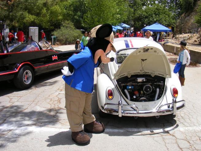 Mickey checking Herbie's engine