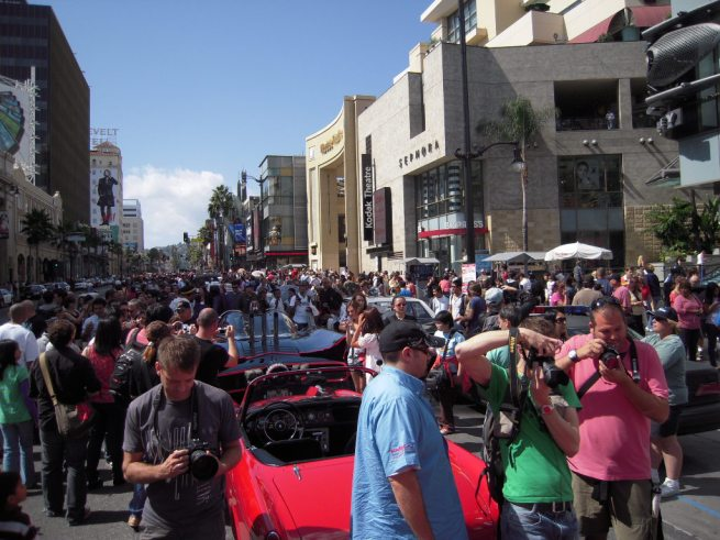 A few fans surround the Batmobile and Get Smart cars!